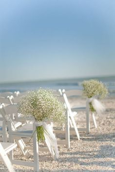 Simple outdoor decor idea, maybe with different flowers that are a little less beachy.