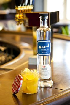 Dawn's Early Light by Jane Elkins: 2 oz Hangar 1 Straight Vodka ¾ lemon, sliced 2 tbsp apricot preserves  - Combine ingredients in small, airtight container, such as a jam jar. Muddle ingredients with wooden spoon. Add ice. Shake for 20 seconds to chill. Top with a splash of club soda