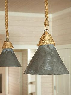 Funnel pendent lights made from old steel funnels and rope.