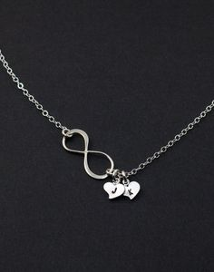 Infinity Necklace. Heart Silver Necklace. Personalized Jewelry. His and Her initials, friendship, family gift,Couple Infinity Love. $31.50, via Etsy.