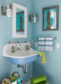 Santa Barbara Design House and Gardens Showhouse | Nursery Bath designed by Carla Lane featuring the Marine Wall Lights over the sink.