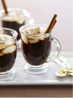 Hot cocoa with ice cream and cinnamon sticks.