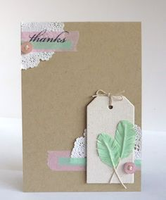 Making little feathers using Japanese washi tape with a little piece of twine