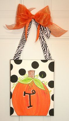 Personalized Pumpkin Canvas Hand Painted Door Hanger--also a shaped candy corn and pumpkin on the site. I could do this!!!