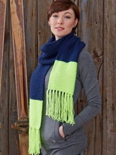 Wrap yourself in style with this neon-accented knit scarf pattern. Knit entirely in garter stitch, the Bold Beginner Scarf makes a great pattern for fledgling knitters and skilled crafters alike.