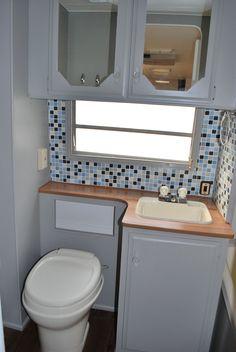 Caravan renovation ideas on pinterest vintage campers for Travel trailer bathroom ideas