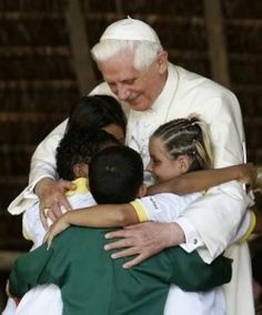 Pope Benedict XVI with children.