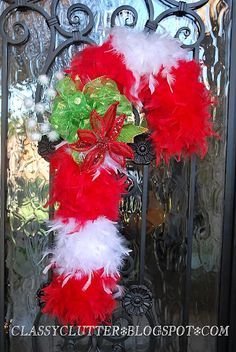 Use feather boas (you know you have some...) to make your own Candy Cane Door Hanger ~ DIY