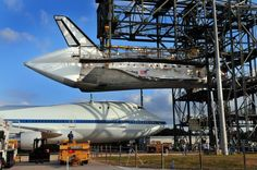Apr. 15, 2012: Crews at the Kennedy Space Center work on attaching the space shuttle Discovery to a modified 747.