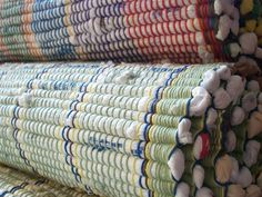 """""""I have been upcycling plastic bags into rugs for over 2 years. They are woven on traditional rag rug loom from the 40′s. I have upcycled over 1,ooo bags into functional sturdy rugs"""
