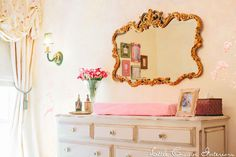 Girl's pink and gold traditional nursery by Little Crown Interiors