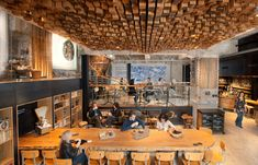 The ceiling in the Starbucks Amsterdam store features an undulating relief composed of 1,876 hand-cut and stained wooden blocks forming the face of our Siren. ceiling design, restaurant interiors, coffee, amsterdam, concept stores, wooden blocks, travel destinations, restaurant interior design, starbucks