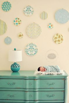 Circles of fabric on walls.... idea for nursery...