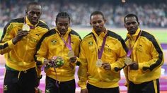 Gold medallists Usain Bolt, Yohan Blake, Michael Frater and Nesta Carter of Jamaica celebrate on the podium during the medal ceremony for the Men's 4 x 100m Relay Final on Day 15 of the London 2012 Olympic Games at Olympic Stadium