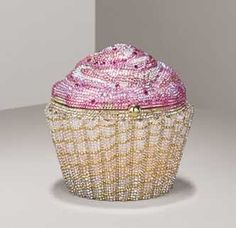 """1- Fancy Shmancy Cupcake Minuaduiere's  From the Judith Leiber Collection at Neiman Marcus. It's the Strawberry Cupcake Minuaduiere and goes for over $4K.. Fully beaded with rose and light pink Austrian crystals...Ou la la. And in case you didn't know.. a Minuaduiere is """"A small ornamental case for a woman's cosmetics, jewelry, or personal items that is often carried as a handbag."""""""