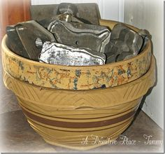 APP ~Tammy  Yellow ware bowl and antique tin cookie cutters    www.aprimitiveplace.net