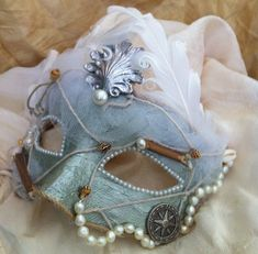 Lady Sea Siren  Vintage Venetian Mask. I think I pinned a very decorative mask. This one is so very simple in structure even I could make it.