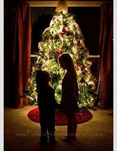 Christmas photo-silhouette children, tree backdrop