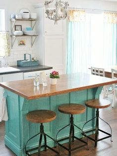 A small kitchen island with a furniture feel and seating could work nicely.