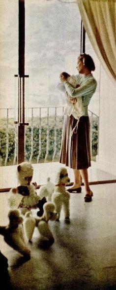 Princess Grace and newborn Princess Caroline in the window of their nursery.