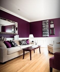 Our living room is not quite as big, nor is the color quite that shade, but we have a purple living room with white trim and brown, cream, and green accents. It really makes for a cozy comfortable setting for any kind of company; business, family, or friends.