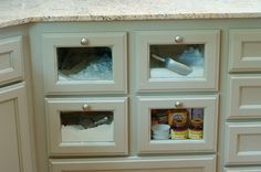 Flour/sugar drawers in a cabinet. Love the glass fronts!  (The Pioneer Woman)