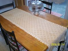 Hand crocheted table runner.  Crocheted in an open diamond shapped pattern.. $125.00, via Etsy.
