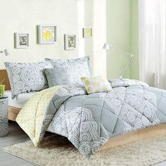 Transform your bedroom into a chic retreat with the Cozy Soft Helena Comforter Set. Featuring a stylish soft grey and white lace design, the super soft comforter reverses to a cheery yellow and white polka dot pattern for a charming change of scenery.