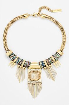 Amazing bib necklace to pair with a simple tee.