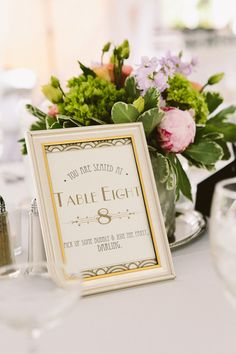 Art Deco table numbers, photo by Zac Wolf http://ruffledblog.com/mile-away-restaurant-wedding #weddingideas #tablenumbers