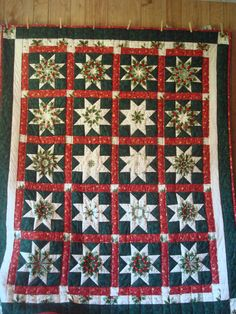 Christmas Stars quilt.  A great star block quilt. Peace, Robert from nancysfabrics.com