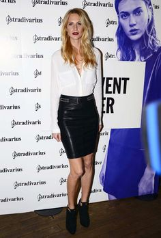 Poppy Delevingne in a leather pencil skirt and white blouse