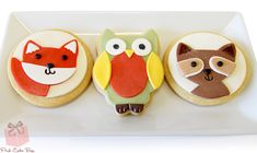 Cute woodland creature cookie favors for a baby shower including a a fox, raccoon and owl.