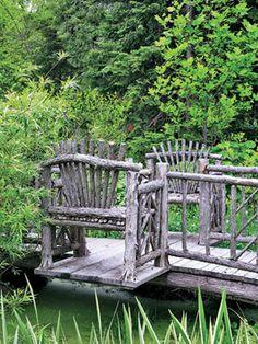 Rustic cedar benches as part of a pond bridge