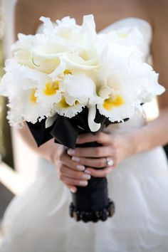 Beautiful black and white bouquet with a splash of yellow.