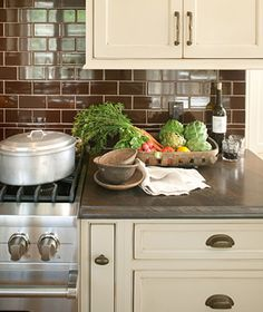 """countertops - Check out the leathered granite counter tops… It's 'Copper Legnia' and it came from Daltile. To achieve the finish, Amy said """"they apply a chemical wash, whereas with a honed or polished finish they use sandpaper""""."""