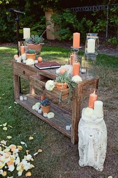 guest book table - love the terra cotta pots and candles with the succulents