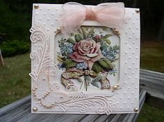 Soni used the Spellbinders Labels 12 to make the frame for the window. She also used the Cheery Lynn Victorian Romance Flourish die and the dots embossing folder by Crafts-too. By using the 3-D Antique Roses and the pretty pale pink card stock, it truly gave it a vintage look.