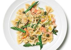 Mix a 7 1/2 oz. can salmon (307), drained; 1 1/2 cups blanched asparagus pieces (49); 3 Tbsp lemon juice (11); 3 Tbsp chopped dill (1); 2 1/2 Tbsp olive oil (298); 2 Tbsp capers (4); 2 tsp lemon zest (4); and 1/2 tsp each salt (0) and pepper (3) in a bowl Stir in 4 cups cooked farfalle (bow tie) pasta (840) and 1/3 cup shredded Parmesan (142)