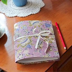 A step-by-step guide to making your own sweet fabric journal covers.
