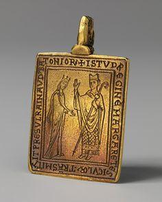 Reliquary Pendant, 1174–77  English  Gold    L. 2 in. (5.1 cm), W. 1 1/4 in. (3.2 cm)  Pulitzer Bequest Fund, 1963 (63.160)