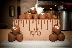 Traditional chocolate groom's cake with tuxedo chocolate covered strawberries.  The monogram is a nice modern touch.  Baker: Fancy Cakes By Lauren. Event Planner: One Event Design. Photographer: Kelly Garsee Photography monogram, chocol groom, jb groom, cake decor, groom cake, baker corner