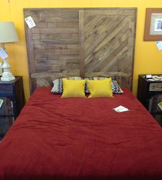Queen size headboard made from reclaimed pallet wood. Custom stain color created for customer.