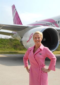 The pink uniform designed for Delta's female flight attendants in support of the Breast Cancer Research Foundation (BCRF). Pink plane in the background!