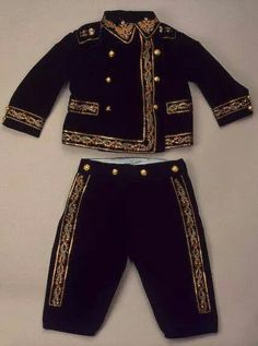 The suit belonging to Tsarevich Alexei Nikolaevich Romanov of Russia.The outfit has elements of the Russian navy.As Alexei was haemophilic he would unlikely be able to join any of the military forces in future years.So this outfit enabled him to be so-called involved.A♥W