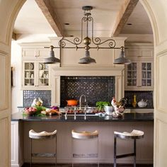 Design your own beautiful French country kitchen design with some twists, vintage fixtures, alcove stove, arched entryway, contemporary furniture - French Furniture yourself for free! Learn it at http://www.countryfrenchfurniture.net/