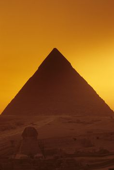 The Great Sphinx and Pyramid of Khufu at sunset.