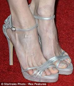 Not a thing is out of place in Emmy Rossum's red carpet look - except maybe her little toe