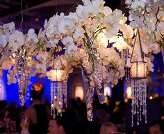 Flower arrangement hanging over table.