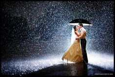Dancing in wedding dress in the rain